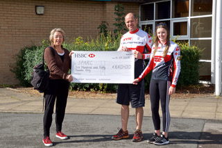 Jean Shirley is presented with Matt and Rebecca's cheque for £640